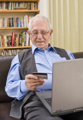 an older gentleman enjoying the advantages of shopping online